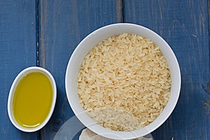 codfish-rice-olive-oil-garlic-blue-wooden-background-60547620